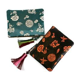 Clutch bag of traditional pattern and leather combination (L)